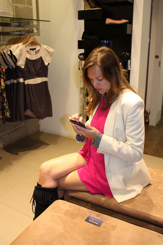 Senior Fashion Editor Natalie Wansborough-Jones tweeting from the store