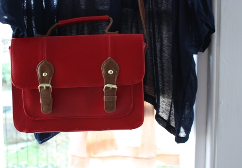Red Primark satchel with tan faux leather buckles
