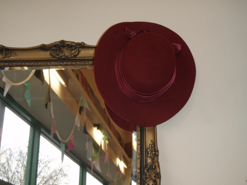 Gilt mirrors and vintage hats at Clic Shop