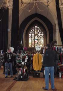 Vintage stalls under stained glass windows at Circomedia