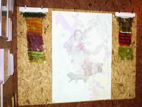 A student projects their illustrations onto a chipboard backdrop