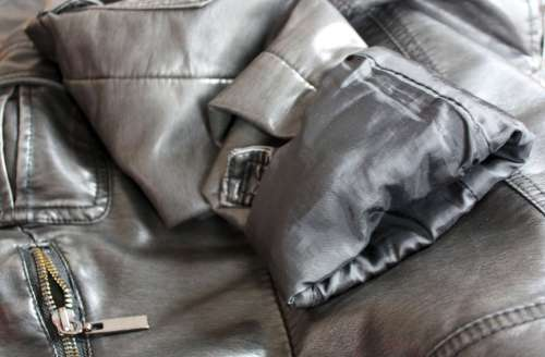 Leather jacket with rolled up sleeves
