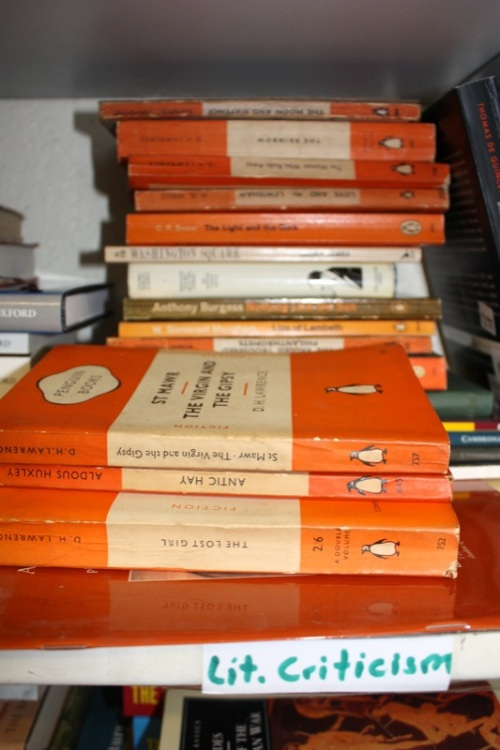 Piles of Penguin books in the charity shop store room