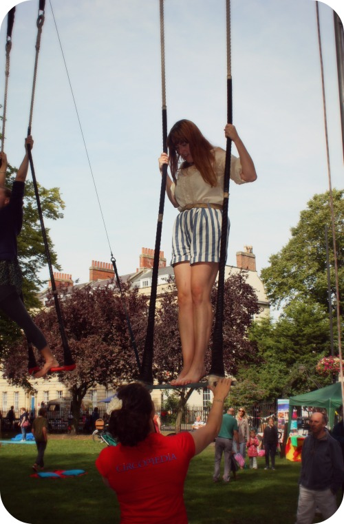 Attempting the trapeze in Portland Square