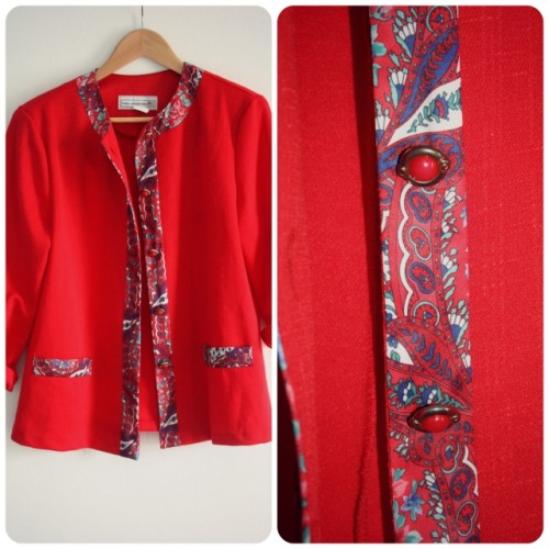 Red collarless box jacket with paisley detailing